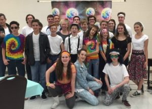 Teens dressed in decades costumes