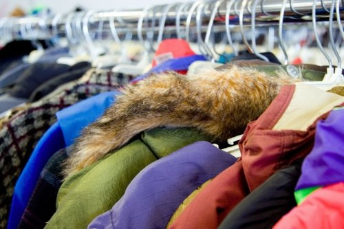 Warm winter coats hanging on a rack