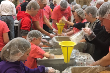 Woodhaven members and friends filled the room and filled meal bags for Rise Against Hunger.