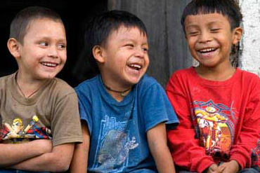Laughing boys from Guatemala in colorful shirts